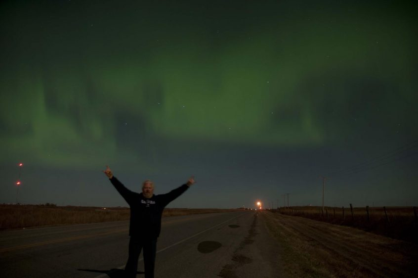 Nico and aurora borealis, northern lights near Pilot Butte, Saskatchewan